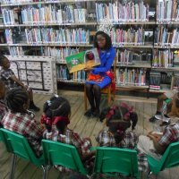 Gallery » Library Services » Queen Reading
